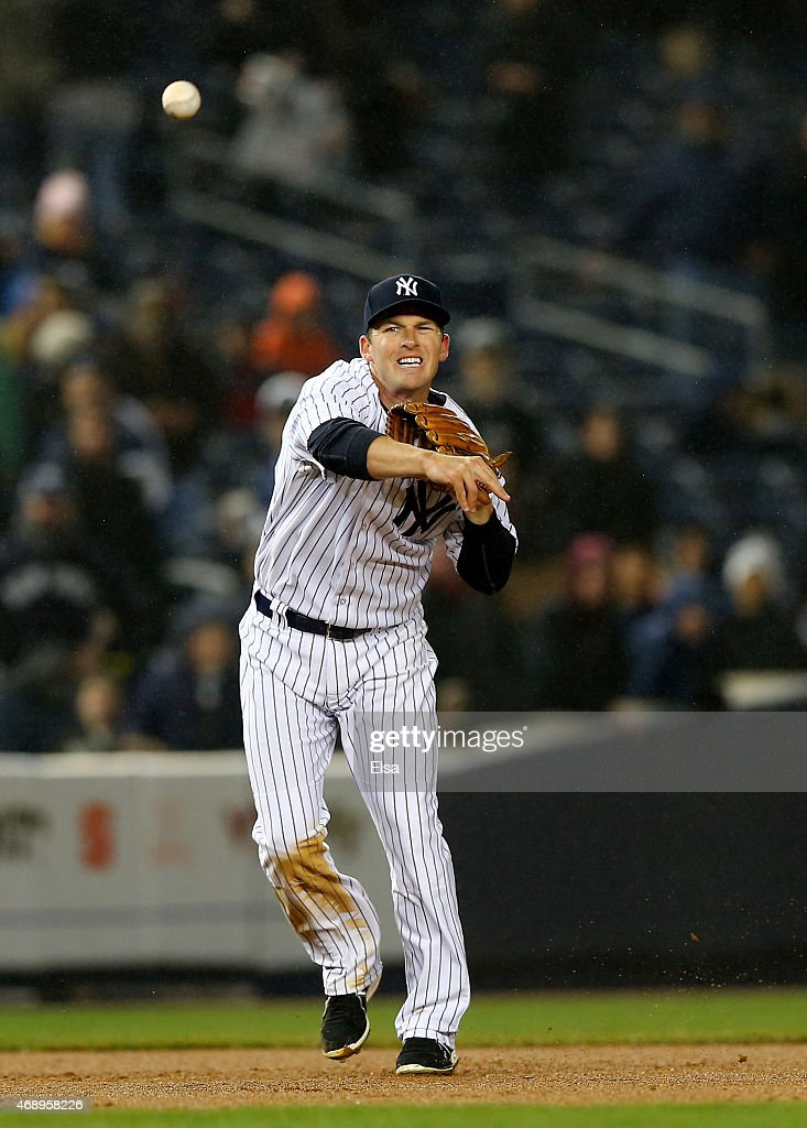 <a gi-track='captionPersonalityLinkClicked' href=/galleries/search?phrase=Stephen+Drew&family=editorial&specificpeople=757520 ng-click='$event.stopPropagation()'>Stephen Drew</a> #14 of the New York Yankees fields a hit by Jose Reyes #7 of the Toronto Blue Jays and sends it to first for the final out of the game on April 8, 2015 at Yankee Stadium in the Bronx borough of New York City.The New York Yankees defeated the Toronto Blue Jays 4-3.