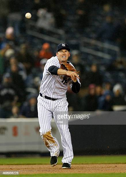 Stephen Drew of the New York Yankees fields a hit by Jose Reyes of the Toronto Blue Jays and sends it to first for the final out of the game on April...
