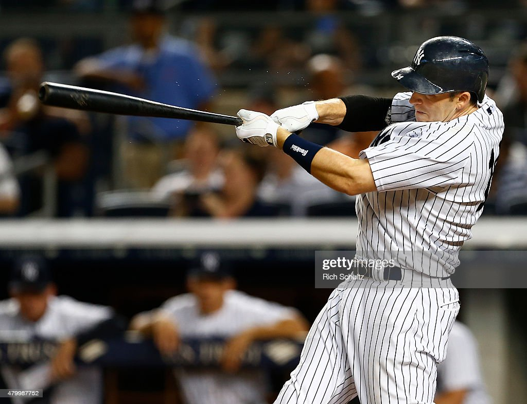 Stephen Drew #14 of the New York Yankees hits a home run in the eighth inning against the Oakland Athletics during a MLB baseball game at Yankee Stadium on July 8, 2015 in the Bronx borough of New York City. The Yankees defeated the A's 5-4.