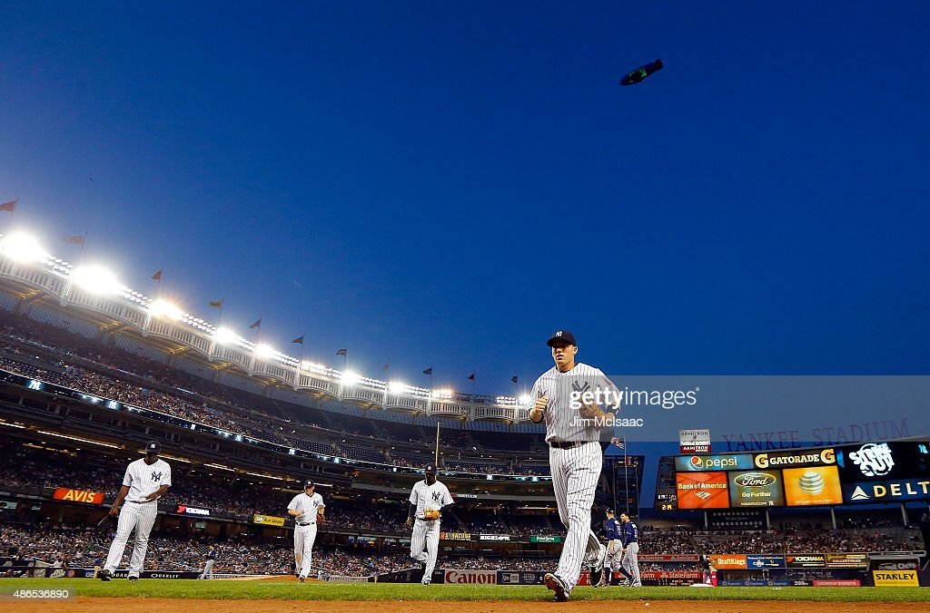 Stephen Drew #14 of the New York Yankees (R) leads his teammates off the field after the second inning against the Tampa Bay Rays at Yankee Stadium on September 4, 2015 in the Bronx borough of New York City.