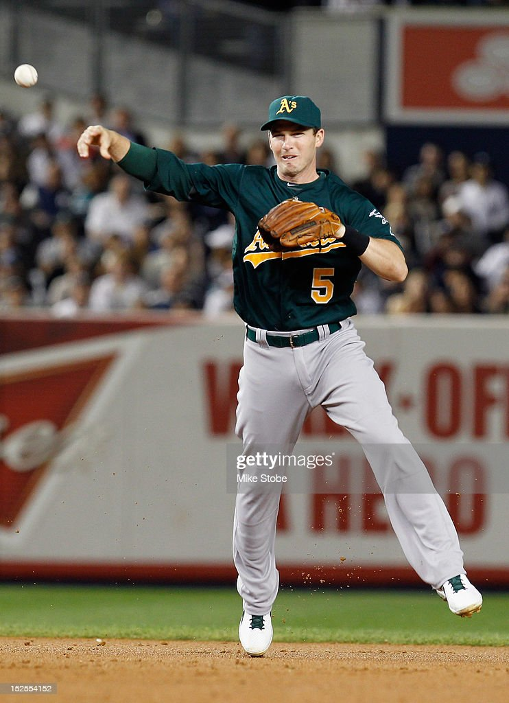 <a gi-track='captionPersonalityLinkClicked' href=/galleries/search?phrase=Stephen+Drew&family=editorial&specificpeople=757520 ng-click='$event.stopPropagation()'>Stephen Drew</a> #5 of the Oakland Athletics throws after fielding the ball against the New York Yankees at Yankee Stadium on September 21, 2012 in the Bronx borough of New York City.