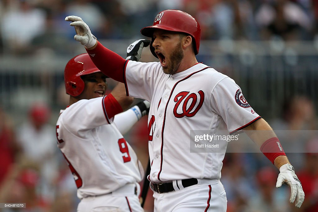 Stephen Drew #10 of the Washington Nationals celebrates with teammate Ben Revere #9 after hitting a solo home run in the eighth inning against the Chicago Cubs at Nationals Park on June 15, 2016 in Washington, DC.
