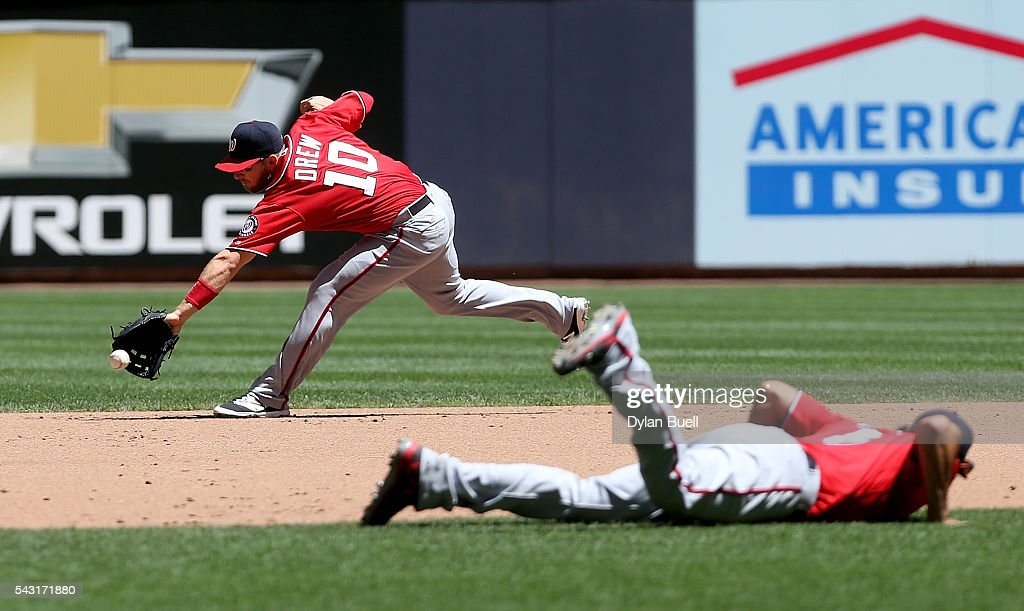 <a gi-track='captionPersonalityLinkClicked' href=/galleries/search?phrase=Stephen+Drew&family=editorial&specificpeople=757520 ng-click='$event.stopPropagation()'>Stephen Drew</a> #10 of the Washington Nationals fields a ground ball in the fourth inning against the Milwaukee Brewers at Miller Park on June 26, 2016 in Milwaukee, Wisconsin.