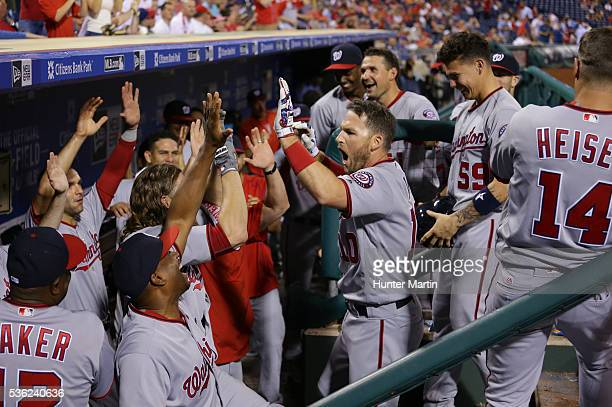 Stephen Drew of the Washington Nationals high fives teammates in the dugout after hitting a solo home run in the ninth inning during a game against...