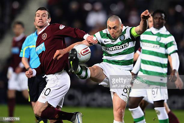 Stephen Elliott of Hearts tackles Scott Brownof Celtic during the Scottish Clydesdale Bank Premier League match between Hearts and Celtic at...