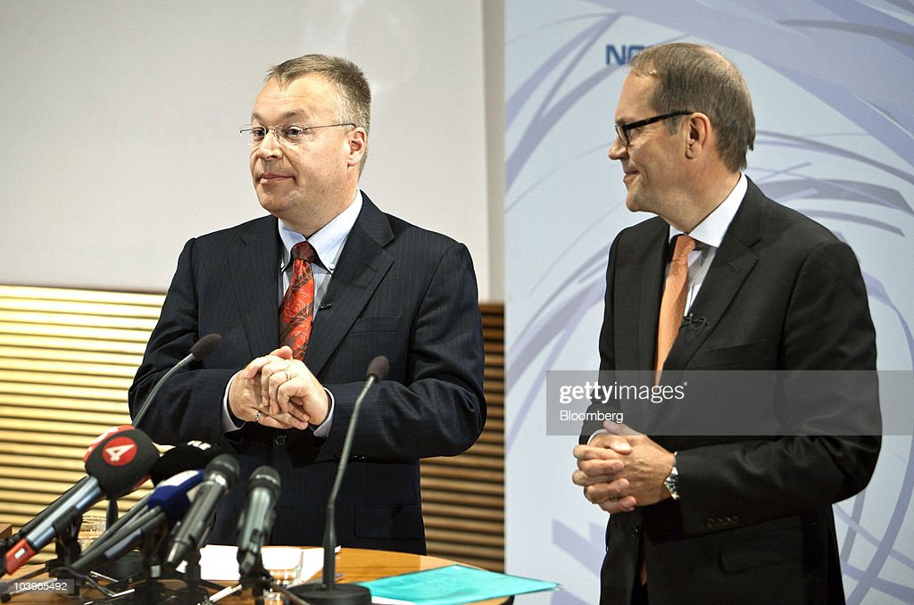 Stephen Elop, incoming chief executive officer of Nokia Oyj, left, pauses as <a gi-track='captionPersonalityLinkClicked' href=/galleries/search?phrase=Jorma+Ollila&family=editorial&specificpeople=619838 ng-click='$event.stopPropagation()'>Jorma Ollila</a>, chairman of Nokia Oyj, looks on during a news conference at the company headquarters in Espoo, Finland, on Friday, Sept. 10, 2010. Nokia named Elop, head of Microsoft Corp.'s business unit, as chief executive officer after the world's largest mobile-phone maker's struggles to take on Apple Inc.'s iPhone wiped $61 billion off its market value. Photographer: Tomi Setala/Bloomberg via Getty Images