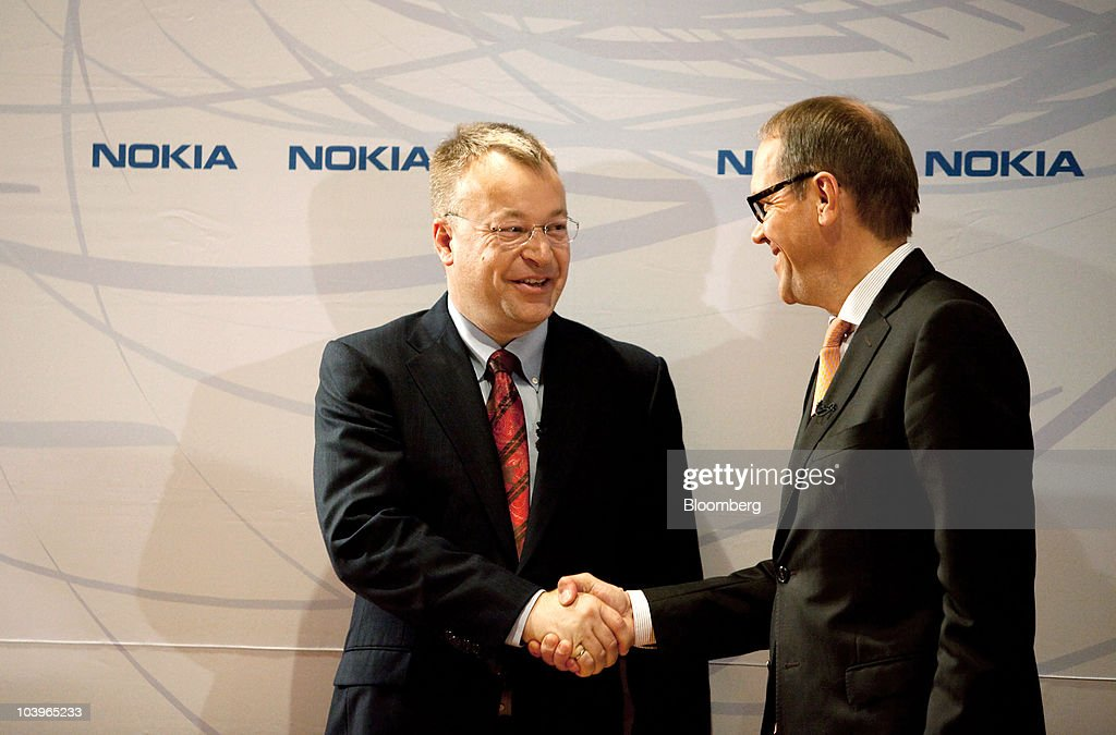Stephen Elop, incoming chief executive officer of Nokia Oyj, left, shakes hands with <a gi-track='captionPersonalityLinkClicked' href=/galleries/search?phrase=Jorma+Ollila&family=editorial&specificpeople=619838 ng-click='$event.stopPropagation()'>Jorma Ollila</a>, chairman of Nokia Oyj, following a news conference at the company headquarters in Espoo, Finland, on Friday, Sept. 10, 2010. Nokia named Elop, head of Microsoft Corp.'s business unit, as chief executive officer after the world's largest mobile-phone maker's struggles to take on Apple Inc.'s iPhone wiped $61 billion off its market value. Photographer: Henrik Kettunen/Bloomberg via Getty Images