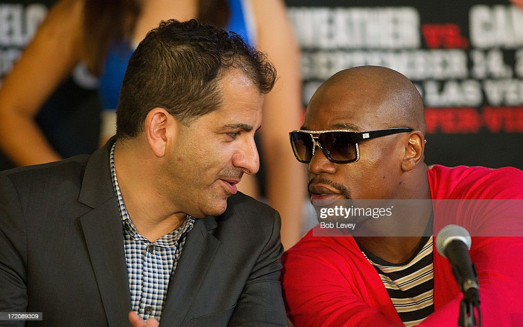 Stephen Espinoza, Executive Vice President & General Manager, SHOWTIME Sports speaks with Floyd Mayweather during a press conference July 1, 2013 at Union Station at Minute Maid Park in Houston, Texas. Floyd Mayweather and Canelo Alvarez are scheduled to fight September 14 at the MGM Grand Garden Arena in Las Vegas, Nevada.