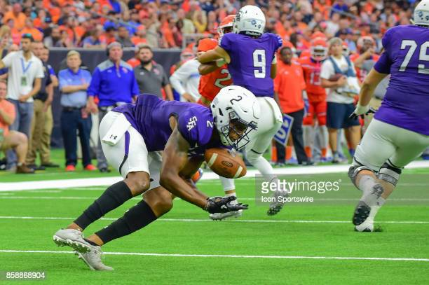 Stephen F Austin Lumberjacks wide receiver Frank Iheanacho works on a short reception during the Battle of the Piney Woods football game between...