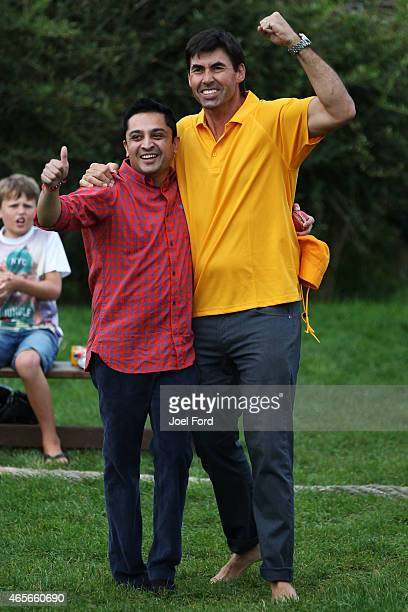 Stephen Fleming celebrates with a teammate during a backyard cricket match captained by Kiwi cricket greats Sir Richard Hadlee and Stephen Fleming...