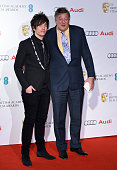 Stephen Fry and Elliot Spencer attend the EE British Academy Awards nominees party at Kensington Palace on February 7 2015 in London England