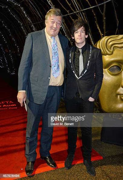 Stephen Fry and Elliott Spencer attend the EE British Academy Awards nominees party at Kensington Palace on February 7 2015 in London England