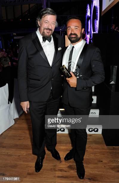 Stephen Fry and Evgeny Lebedev winner of the Best Entrepreneur award attend the GQ Men of the Year awards at The Royal Opera House on September 3...