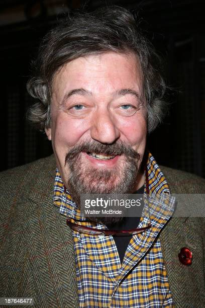 Stephen Fry greets fans at the stage door after the Broadway opening night performance of 'Twelfth Night' at Belasco Theatre on November 10 2013 in...