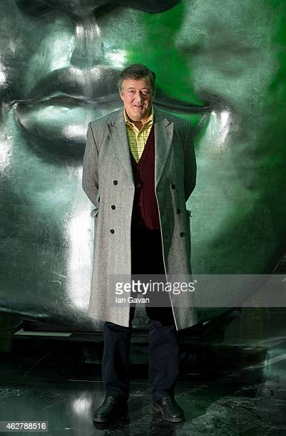 Stephen Fry poses on stage ahead of the British Academy Film Awards at The Royal Opera House on February 5 2015 in London England The annual BAFTA's...
