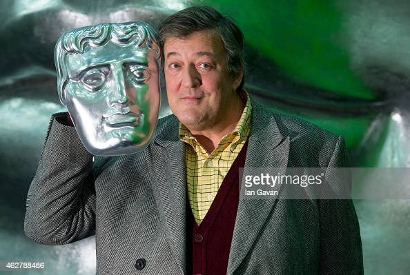 Stephen Fry poses on stage with a BAFTA mask ahead of the British Academy Film Awards at The Royal Opera House on February 5 2015 in London England...