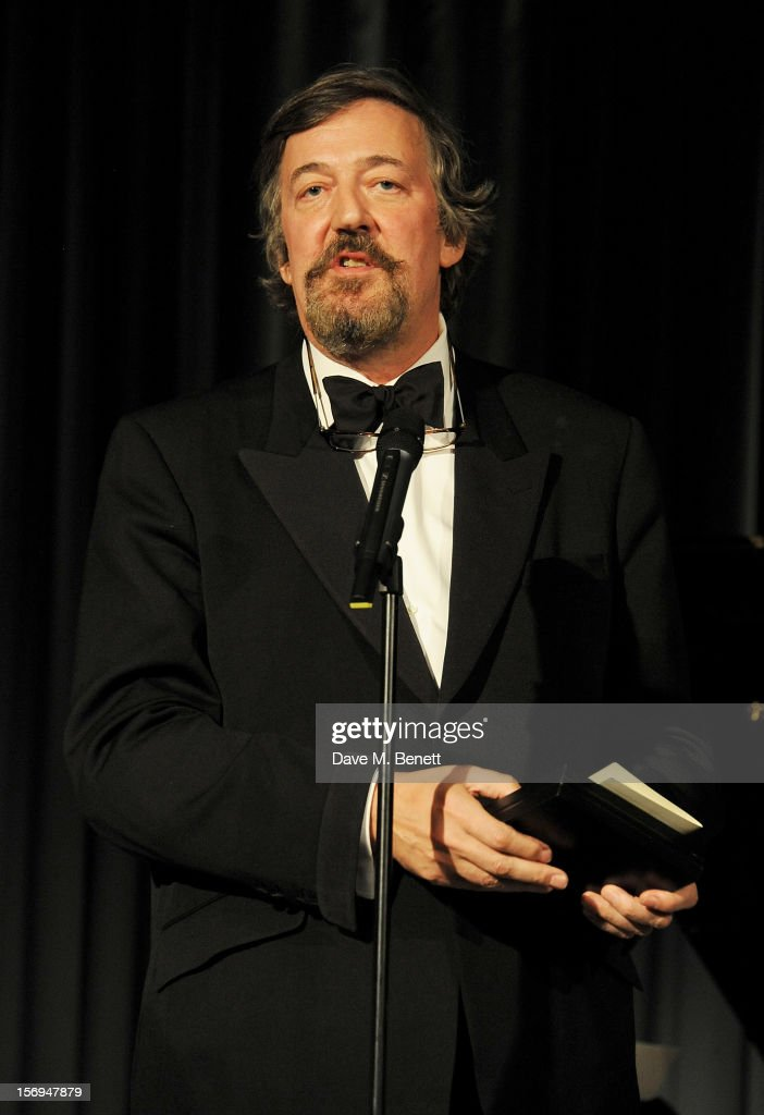 <a gi-track='captionPersonalityLinkClicked' href=/galleries/search?phrase=Stephen+Fry&family=editorial&specificpeople=210809 ng-click='$event.stopPropagation()'>Stephen Fry</a> presents an award at the 58th London Evening Standard Theatre Awards in association with Burberry at The Savoy Hotel on November 25, 2012 in London, England.