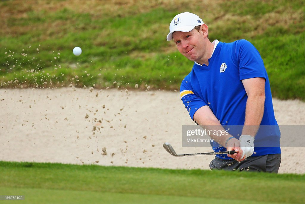 <a gi-track='captionPersonalityLinkClicked' href=/galleries/search?phrase=Stephen+Gallacher&family=editorial&specificpeople=215277 ng-click='$event.stopPropagation()'>Stephen Gallacher</a> of Europe plays out of a bunker on the 17th hole during the Singles Matches of the 2014 Ryder Cup on the PGA Centenary course at the Gleneagles Hotel on September 28, 2014 in Auchterarder, Scotland.