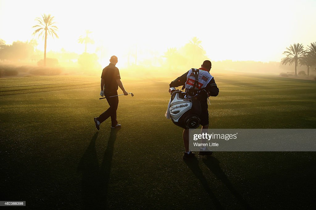 Stephen Gallacher of Scotland and his caddie Damian Moore walk up the 10th fairway during the pro-am ahead of the Omega Dubai Desert Classic on the Majlis Course at the Emirates Golf Club on January 28, 2015 in Dubai, United Arab Emirates