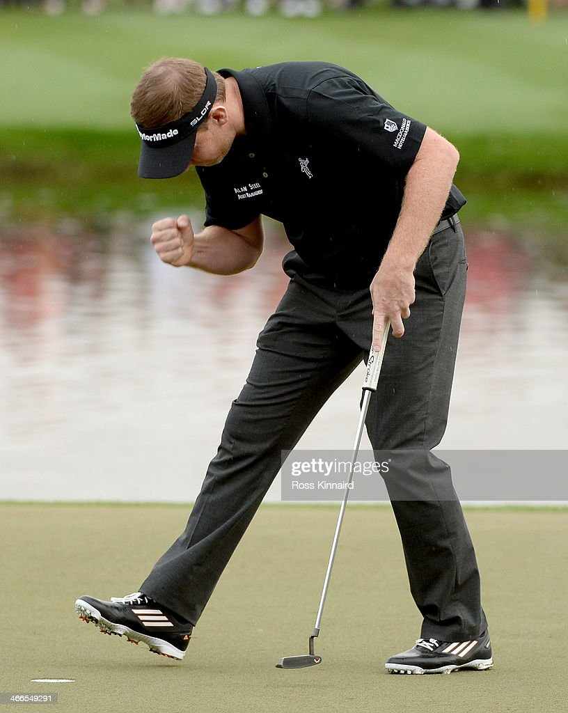 <a gi-track='captionPersonalityLinkClicked' href=/galleries/search?phrase=Stephen+Gallacher&family=editorial&specificpeople=215277 ng-click='$event.stopPropagation()'>Stephen Gallacher</a> of Scotland celebrates after holing his putt on the 18th green during the final round of the Omega Dubai Desert Classic on the Majlis Course at the Emirates Golf Club on February 2, 2014 in Dubai, United Arab Emirates.