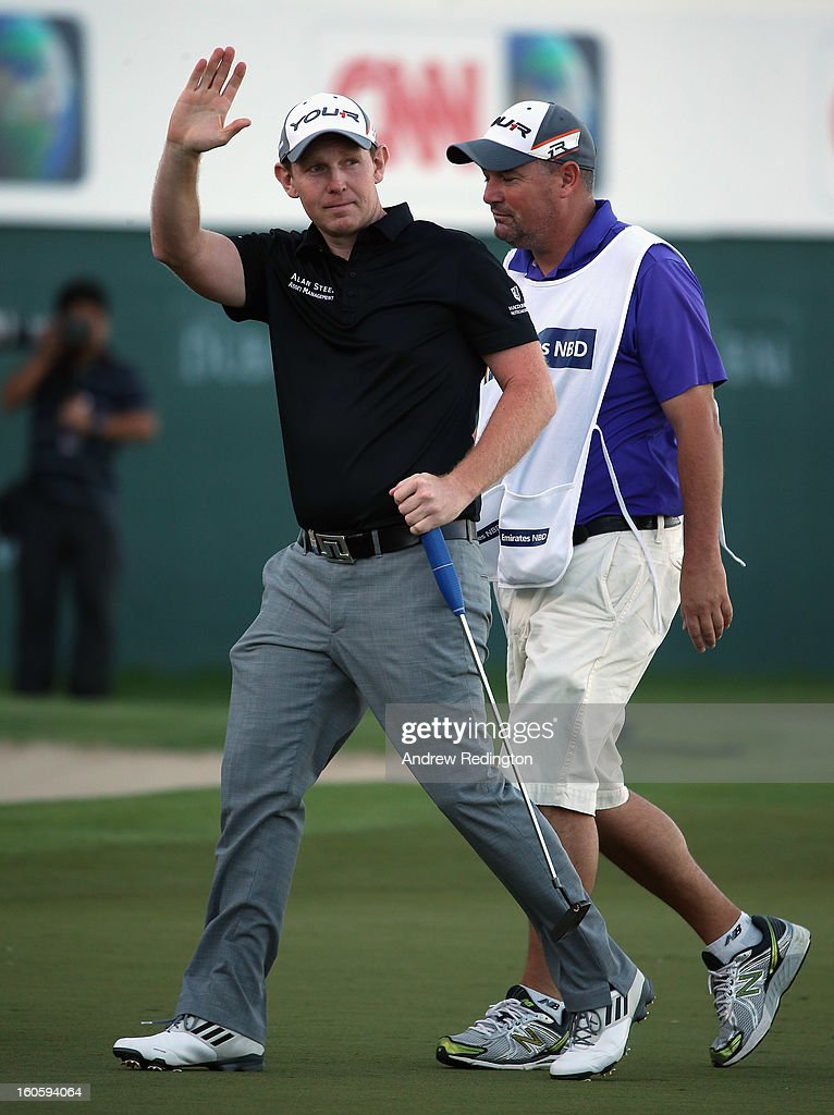Stephen Gallacher of Scotland celebrates with his caddie Damien Moore on the 18th green after winning the Omega Dubai Desert Classic at Emirates Golf Club on February 3, 2013 in Dubai, United Arab Emirates.