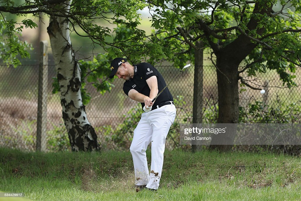 Stephen Gallacher of Scotland hits his 2nd shot on the 9th hole during day one of the BMW PGA Championship at Wentworth on May 26, 2016 in Virginia Water, England.