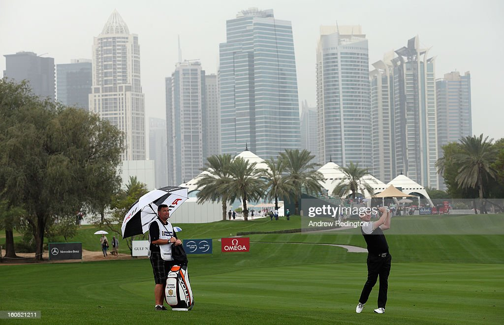 Stephen Gallacher of Scotland hits his second shot on the first hole during the third round of the Omega Dubai Desert Classic at Emirates Golf Club on February 2, 2013 in Dubai, United Arab Emirates.