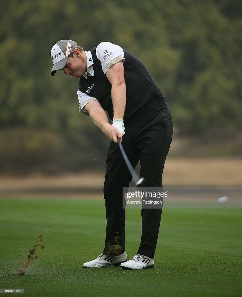 Stephen Gallacher of Scotland hits his second shot on the third hole during the third round of the Omega Dubai Desert Classic at Emirates Golf Club on February 2, 2013 in Dubai, United Arab Emirates.