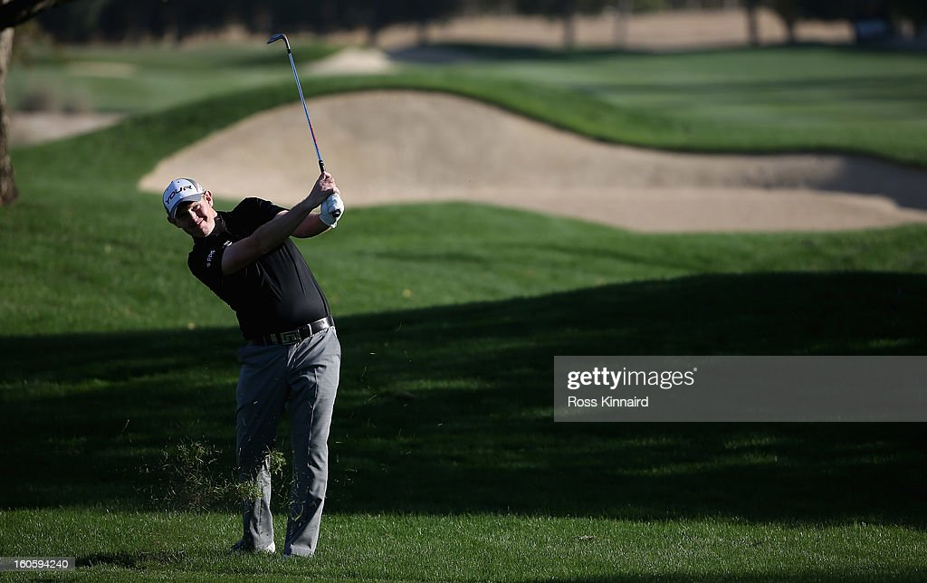 Stephen Gallacher of Scotland holes out with his second shot for an eagle two on the par four 16th hole during the final round of the Omega Dubai Desert Classic on February 3, 2013 in Dubai, United Arab Emirates.