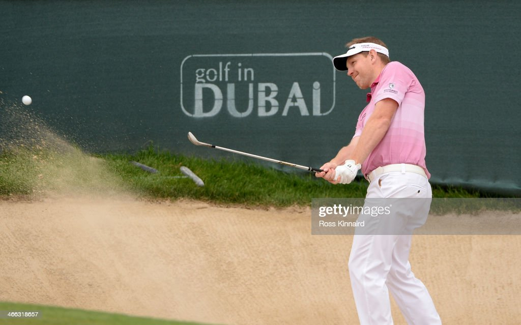<a gi-track='captionPersonalityLinkClicked' href=/galleries/search?phrase=Stephen+Gallacher&family=editorial&specificpeople=215277 ng-click='$event.stopPropagation()'>Stephen Gallacher</a> of Scotland in action during the third round of the Omega Dubai Desert Classic on the Majlis Course at the Emirates Golf Club on February 1, 2014 in Dubai, United Arab Emirates.