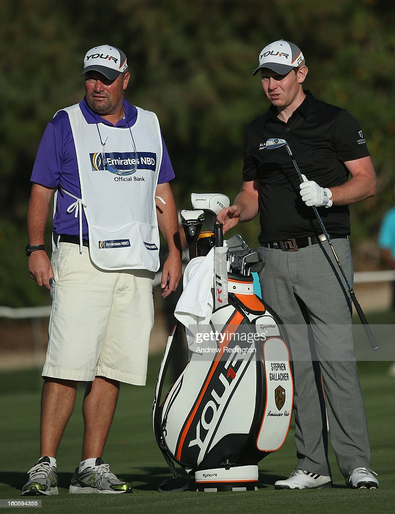 Stephen Gallacher of Scotland in action with his caddie Damien Moore during the final round of the Omega Dubai Desert Classic at Emirates Golf Club on February 3, 2013 in Dubai, United Arab Emirates.