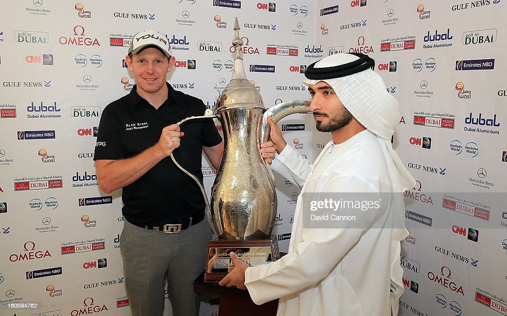 <a gi-track='captionPersonalityLinkClicked' href=/galleries/search?phrase=Stephen+Gallacher&family=editorial&specificpeople=215277 ng-click='$event.stopPropagation()'>Stephen Gallacher</a> of Scotland is presented with the trophy by (L) Sheikh Majid bin Mohammed bin Rashid al Maktoum during the final round of the 2013 Omega Dubai Desert Classic on the Majilis Course at the Emirates Golf Club on February 3, 2013 in Dubai, United Arab Emirates.