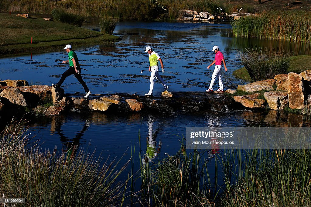 <a gi-track='captionPersonalityLinkClicked' href=/galleries/search?phrase=Stephen+Gallacher&family=editorial&specificpeople=215277 ng-click='$event.stopPropagation()'>Stephen Gallacher</a> of Scotland, <a gi-track='captionPersonalityLinkClicked' href=/galleries/search?phrase=Jamie+Donaldson&family=editorial&specificpeople=241203 ng-click='$event.stopPropagation()'>Jamie Donaldson</a> of Wales and <a gi-track='captionPersonalityLinkClicked' href=/galleries/search?phrase=Tommy+Fleetwood&family=editorial&specificpeople=4450351 ng-click='$event.stopPropagation()'>Tommy Fleetwood</a> of England uses some stepping stones to cross the water from the 17th tee to the 16th green during the second round of the Portugal Masters at Oceanico Victoria Golf Course on October 11, 2013 in Faro, Portugal.
