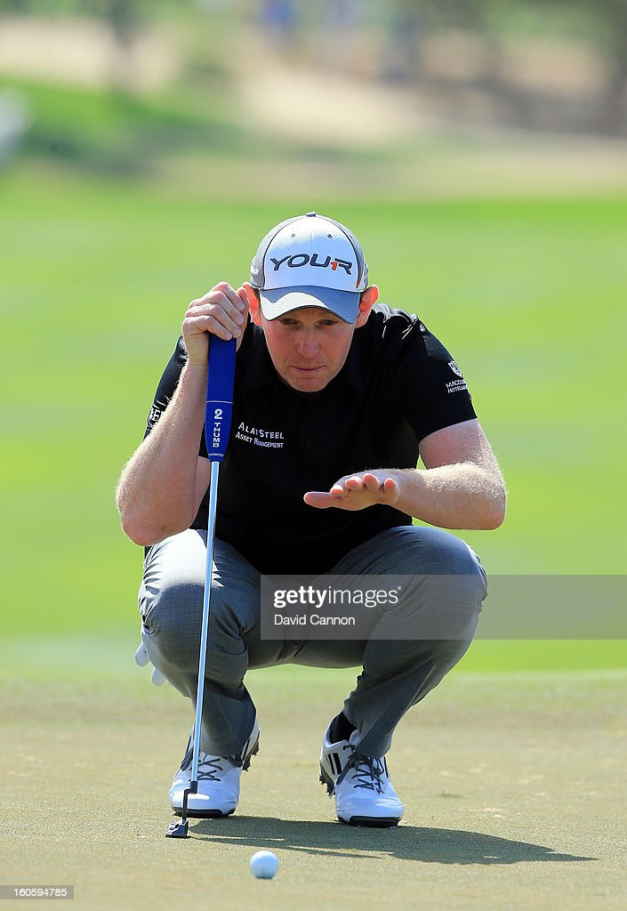<a gi-track='captionPersonalityLinkClicked' href=/galleries/search?phrase=Stephen+Gallacher&family=editorial&specificpeople=215277 ng-click='$event.stopPropagation()'>Stephen Gallacher</a> of Scotland on the first green during the final round of the 2013 Omega Dubai Desert Classic on the Majilis Course at the Emirates Golf Club on February 3, 2013 in Dubai, United Arab Emirates.