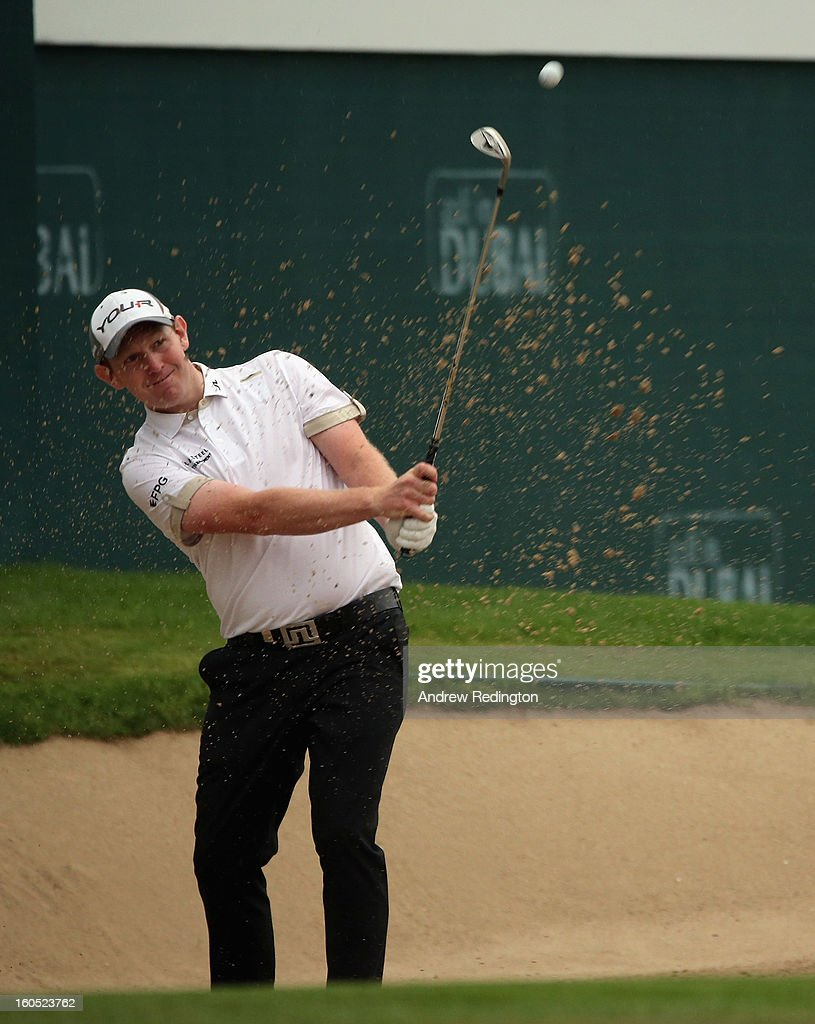Stephen Gallacher of Scotland plays a bunker shot on the 18th hole during the third round of the Omega Dubai Desert Classic at Emirates Golf Club on February 2, 2013 in Dubai, United Arab Emirates.