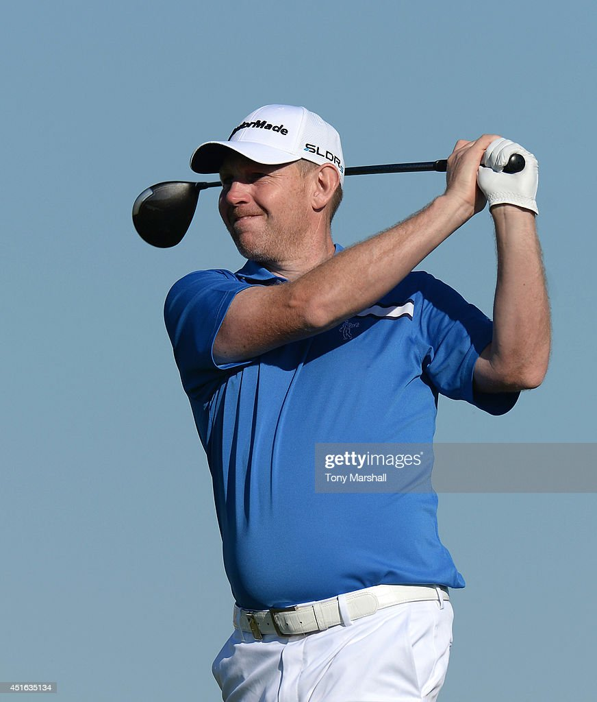 <a gi-track='captionPersonalityLinkClicked' href=/galleries/search?phrase=Stephen+Gallacher&family=editorial&specificpeople=215277 ng-click='$event.stopPropagation()'>Stephen Gallacher</a> of Scotland plays his first shot on the 13th tee during day one of the Alstom Open de France at Le Golf National on July 3, 2014 in Paris, France.
