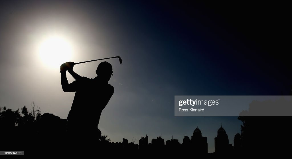 Stephen Gallacher of Scotland plays his second shot on the par five 18th hole during the final round of the Omega Dubai Desert Classic on February 3, 2013 in Dubai, United Arab Emirates.
