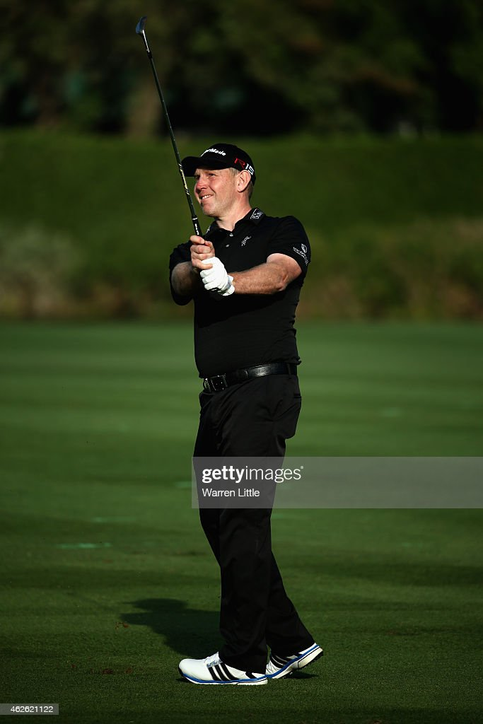 <a gi-track='captionPersonalityLinkClicked' href=/galleries/search?phrase=Stephen+Gallacher&family=editorial&specificpeople=215277 ng-click='$event.stopPropagation()'>Stephen Gallacher</a> of Scotland plays his third shot ointo the 18th green during the final round of the Omega Dubai Desert Classic on the Majlis Course at the Emirates Golf Club on February 1, 2015 in Dubai, United Arab Emirates.