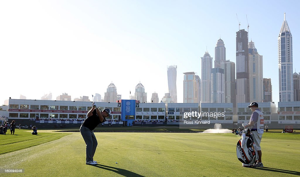 Stephen Gallacher of Scotland plays his third shot on the par five 18th hole during the final round of the Omega Dubai Desert Classic on February 3, 2013 in Dubai, United Arab Emirates.