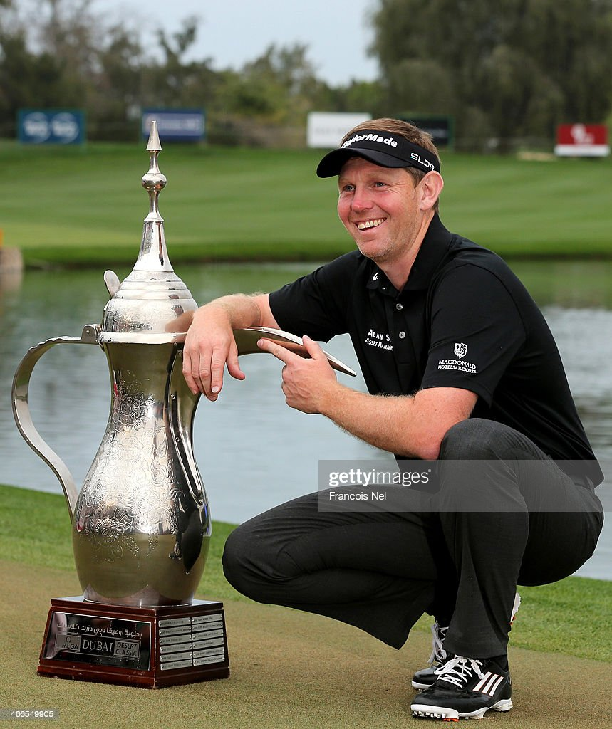<a gi-track='captionPersonalityLinkClicked' href=/galleries/search?phrase=Stephen+Gallacher&family=editorial&specificpeople=215277 ng-click='$event.stopPropagation()'>Stephen Gallacher</a> of Scotland poses wih the trophy after winning the Omega Dubai Desert Classic on the Majlis Course at the Emirates Golf Club on February 2, 2014 in Dubai, United Arab Emirates.