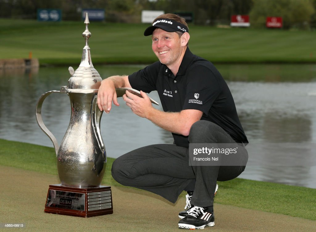 Stephen Gallacher of Scotland poses wih the trophy after winning the Omega Dubai Desert Classic on the Majlis Course at the Emirates Golf Club on...