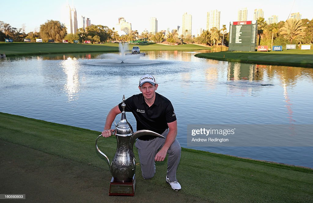 Stephen Gallacher of Scotland poses with the trophy after winning the Omega Dubai Desert Classic at Emirates Golf Club on February 3, 2013 in Dubai, United Arab Emirates.