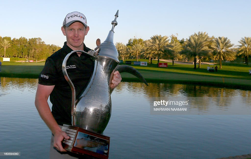 Stephen Gallacher of Scotland poses with the trophy after winning the Dubai Desert Classic in Dubai, on February 3, 2013. Gallacher fired a timely eagle two on the par-4 16th hole and comfortably won the $2.5 million Omega Dubai Desert Classic in the end by three shots.