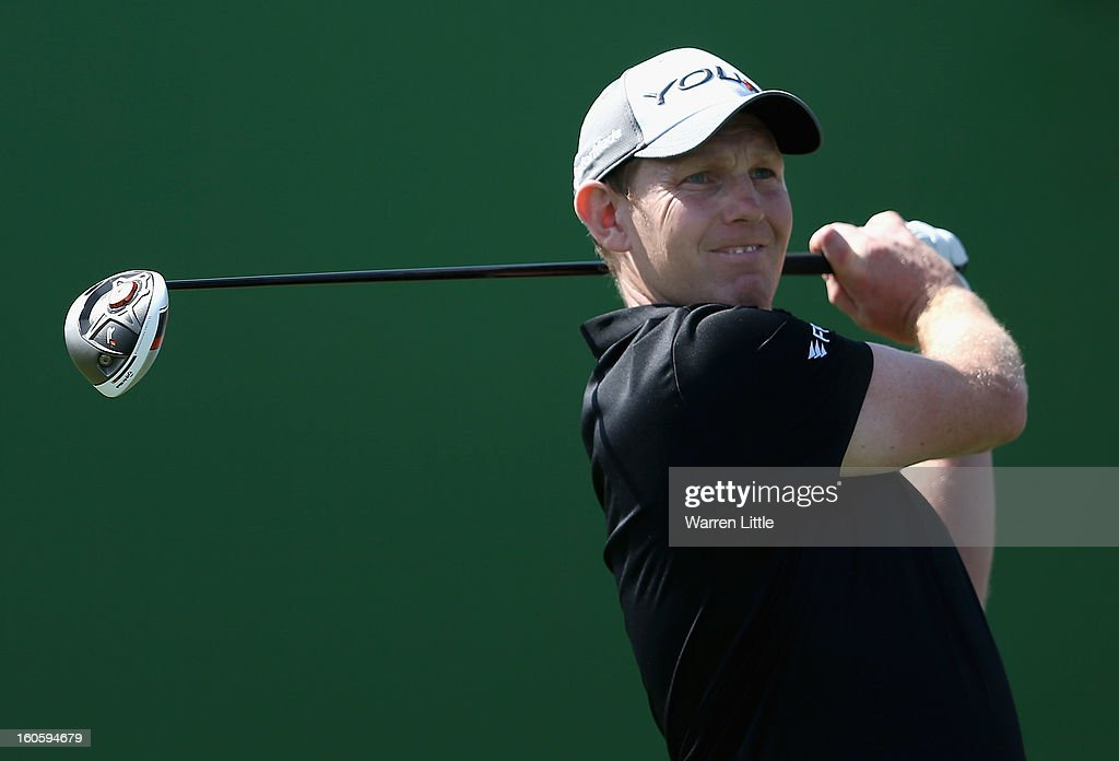 Stephen Gallacher of Scotland tees off on the second hole during the final round of the Omega Dubai Desert Classic at Emirates Golf Club on February 3, 2013 in Dubai, United Arab Emirates.