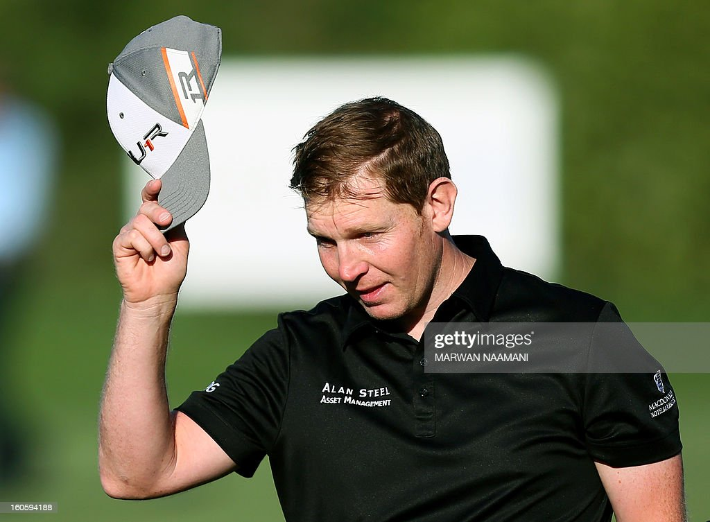 Stephen Gallacher of Scotland tips his cap as he reaches the 18th hole to win the Dubai Desert Classic in Dubai, on February 3, 2013. Gallacher fired a timely eagle two on the par-4 16th hole and comfortably won the $2.5 million Omega Dubai Desert Classic in the end by three shots.