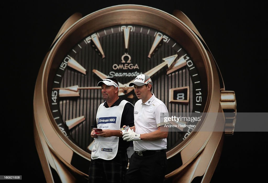 Stephen Gallacher of Scotland waits with his caddie Damian Moore on the seventh hole during the third round of the Omega Dubai Desert Classic at Emirates Golf Club on February 2, 2013 in Dubai, United Arab Emirates.
