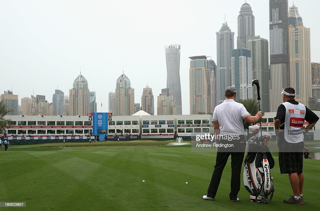 Stephen Gallacher of Scotland waits with his caddie Damian Moore on the 18th hole during the third round of the Omega Dubai Desert Classic at Emirates Golf Club on February 2, 2013 in Dubai, United Arab Emirates.