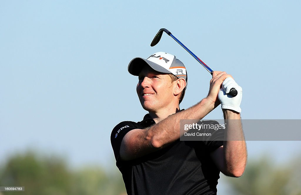 Stephen Gallacher of Scotland watches his second shot to the 16th green that he holed for an eagle two during the final round of the 2013 Omega Dubai Desert Classic on the Majilis Course at the Emirates Golf Club on February 3, 2013 in Dubai, United Arab Emirates.