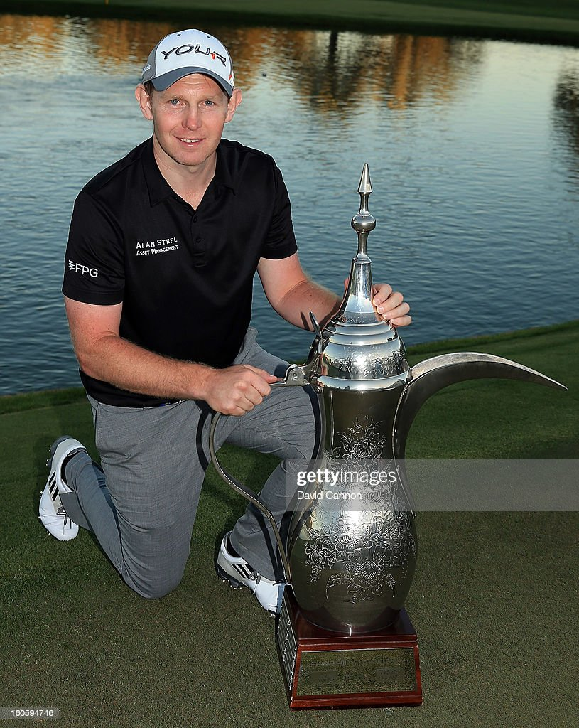 Stephen Gallacher of Scotland with the trophy after the final round of the 2013 Omega Dubai Desert Classic on the Majilis Course at the Emirates Golf Club on February 3, 2013 in Dubai, United Arab Emirates.