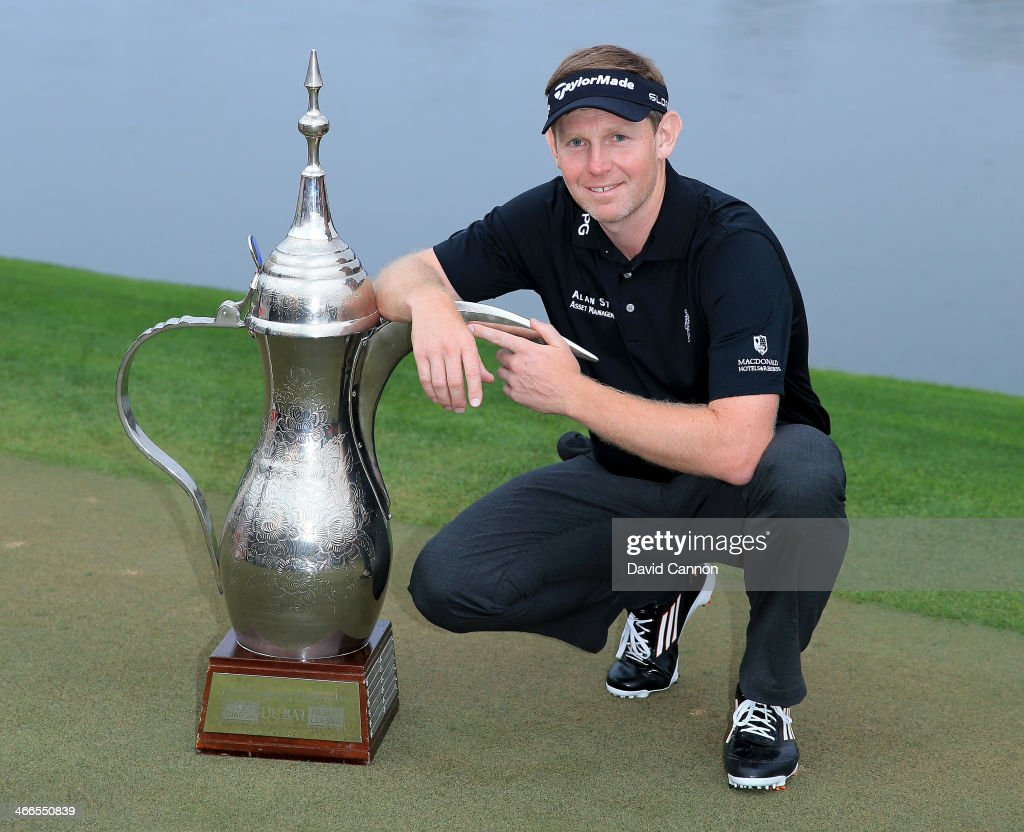 <a gi-track='captionPersonalityLinkClicked' href=/galleries/search?phrase=Stephen+Gallacher&family=editorial&specificpeople=215277 ng-click='$event.stopPropagation()'>Stephen Gallacher</a> of Scotland with the trophy after the final round where he became the first back to back winner of the Omega Dubai Desert Classic on the Majlis Course at the Emirates Golf Club on February 2, 2014 in Dubai, United Arab Emirates.